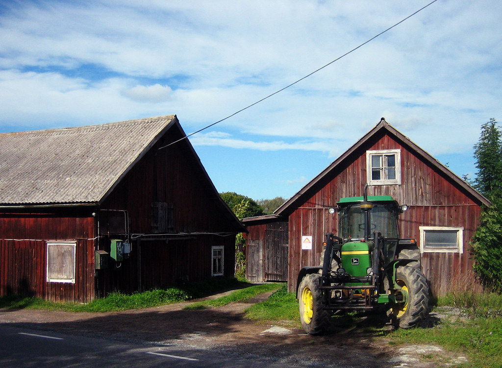 Two old barns and a tractor