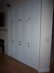 cupboard(0.0), door(0.0), cabinetry(0.0), closet(1.0), furniture(1.0), room(1.0), wardrobe(1.0),