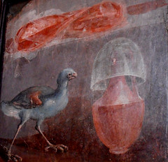 """A purple swamphen and a jug upon whith a crystal bowl; on a higher shelf are hams or perhaps shells"" - wall painting from House of the Deer at Herculaneum, buried by Vesuvius' eruption on 79 AD - Naples, Archaeological Museum"