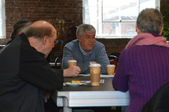Rep. Storms speaks with constituents at a coffee hour in Windsor
