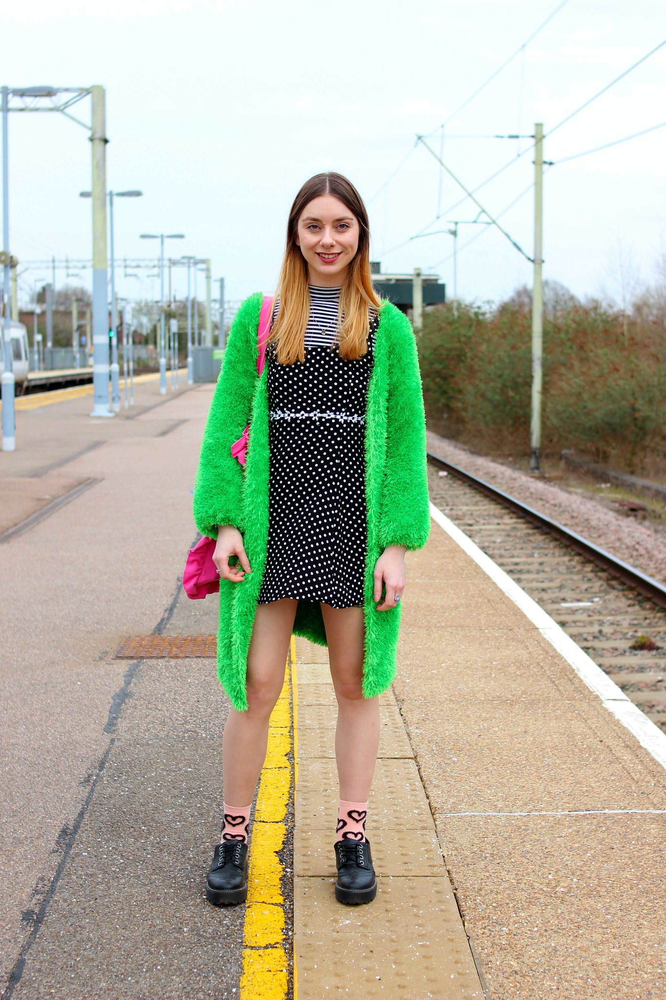Clashing spots and stripes with a bright green cardigan
