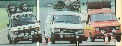 A trio of rally support vans