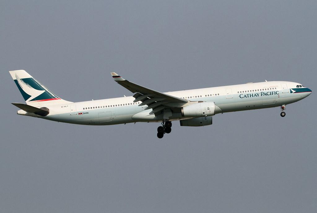 Short final for RWY19R inbound from Hong Kong HKG. Delivered 11/2001.