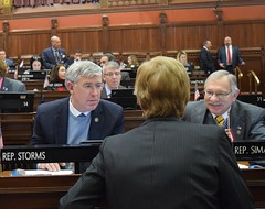 Reps. Storms and Simanski speak with Rep. Zawistowski during Session on 4.19.18
