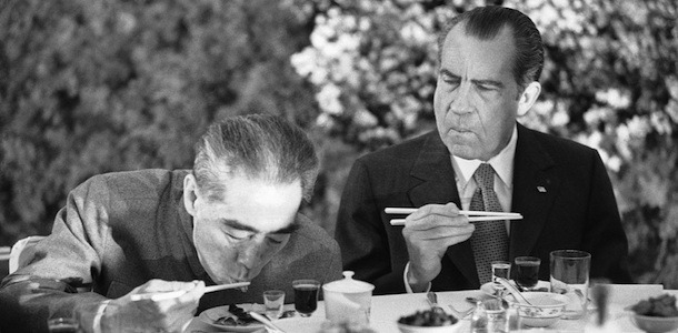 Nixon learning to use chopsticks during his visit to China, 1972