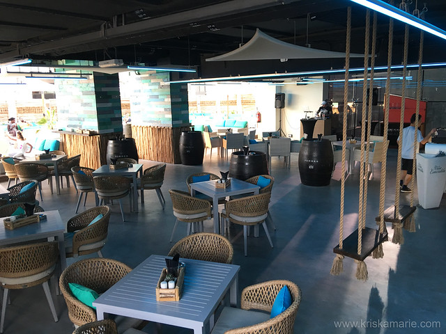Indoor seating at L!QD at Tryp by Wyndham