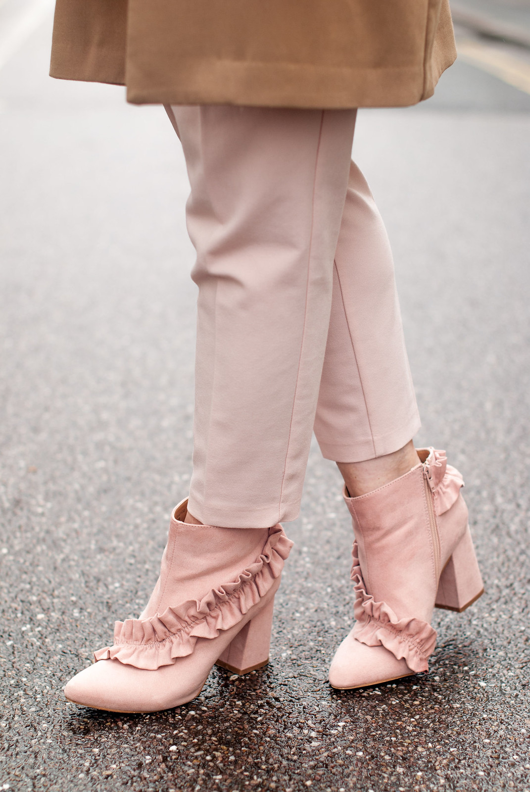 Easter outfit of pastels: Ruffled yellow blouse \ longline camel blazer \ pastel pink peg leg trousers \ tapered pants \ pink ruffle ankle boots | Not Dressed As Lamb, over 40 style