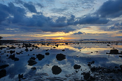 Rocks emerging from the low tide at Klong Muang Beach during sunset