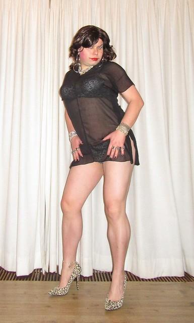 cougar print lingerie visible through little black dress