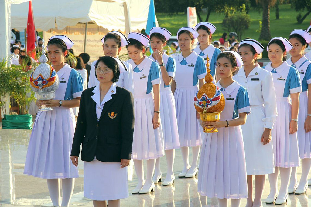Nurses in Thailand conduct a Royal ceremony.