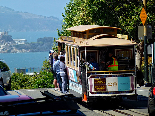 Riding a cable car in San Francisco is an authentic travel experience that travellers shouldn't miss.