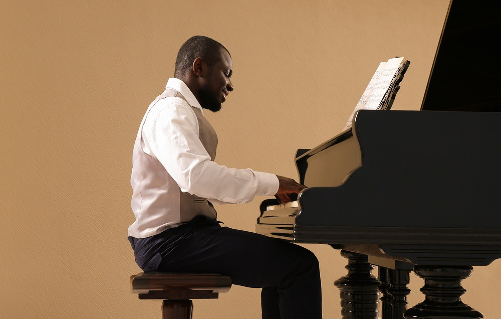 photo of man practicing piano