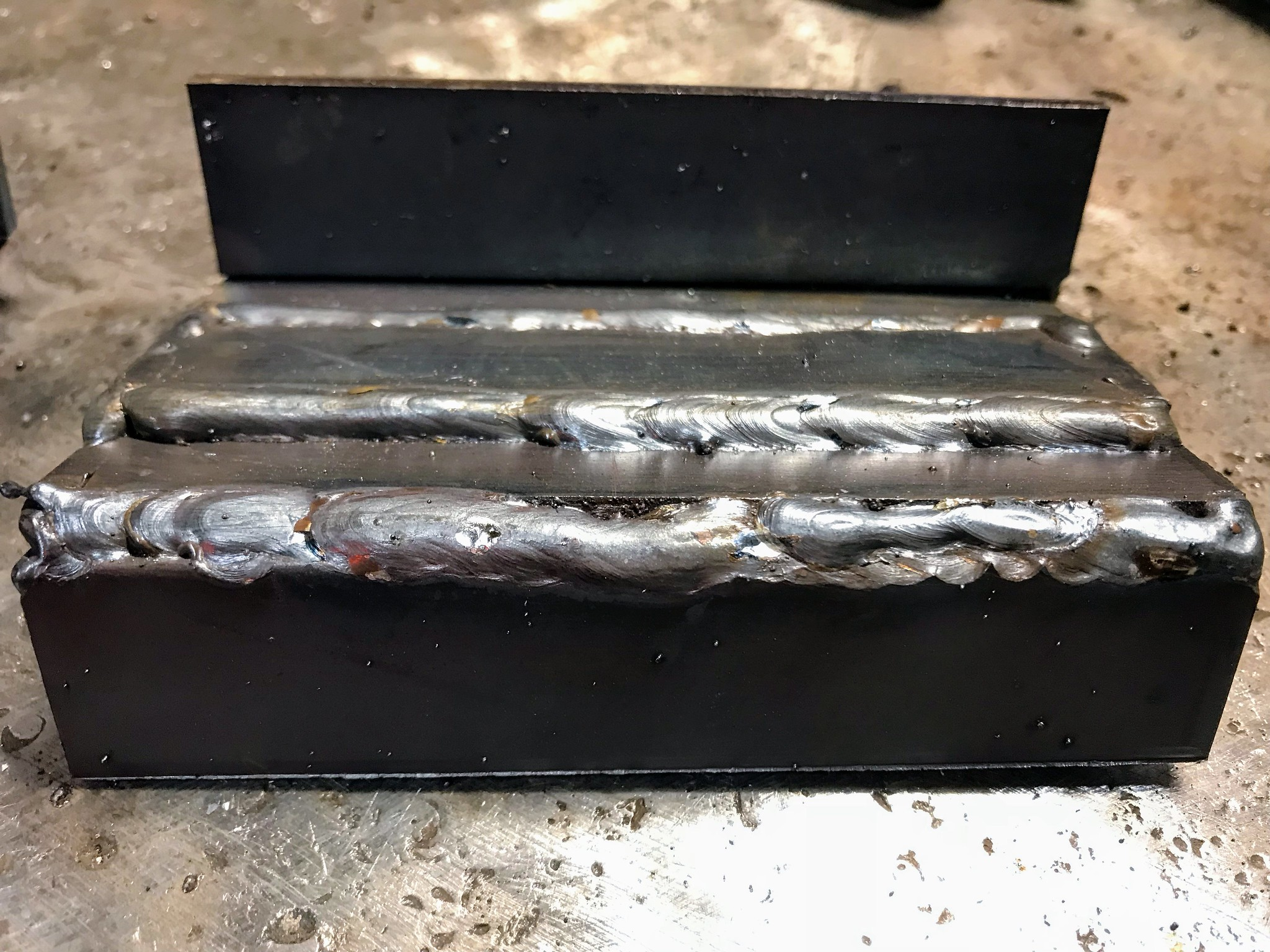 First attempt of the evening. Notice the poor 90º corner weld.
