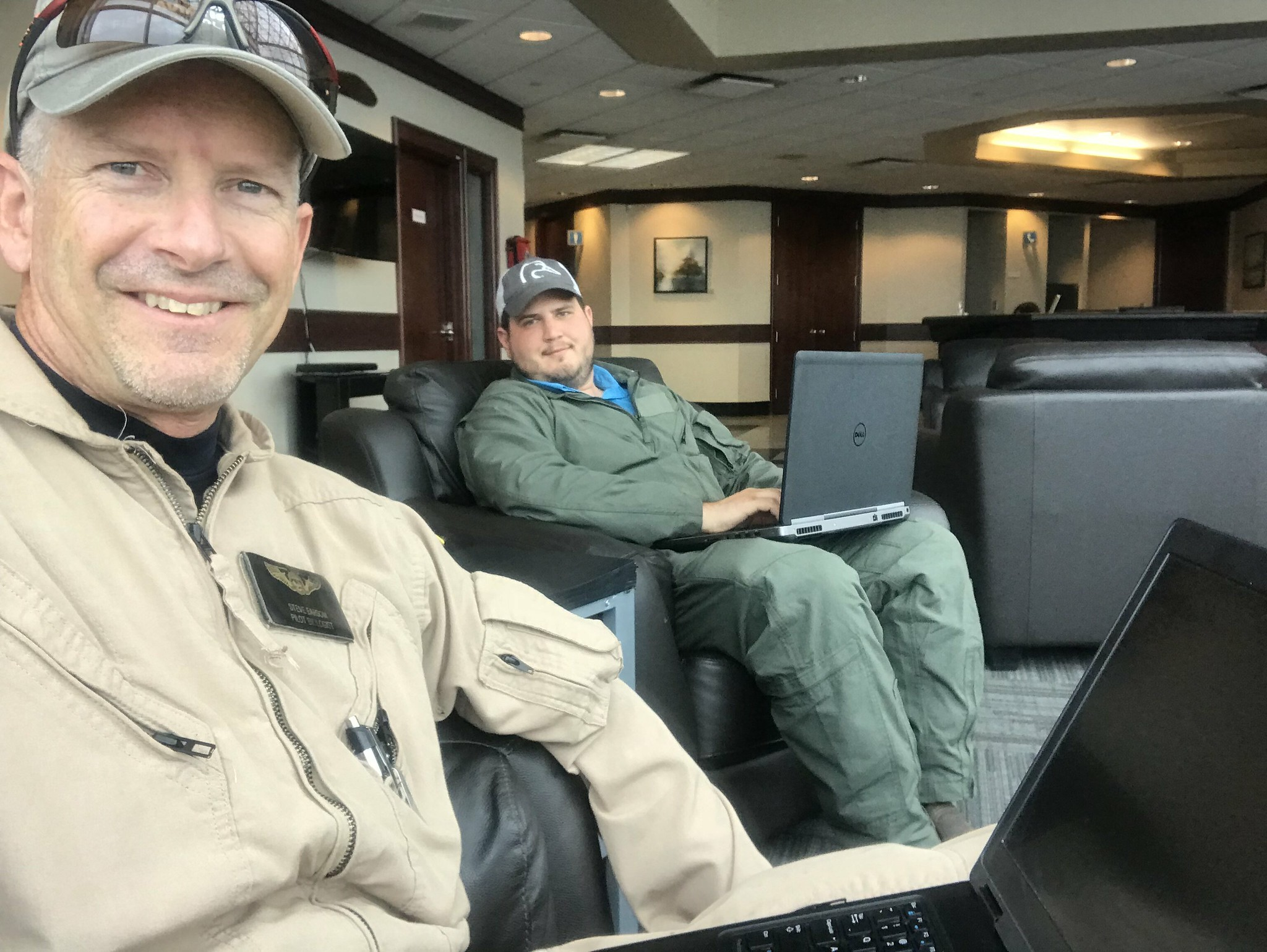 Biologist/Pilot Steve Earsom (L) and Observer Garrett Wilkerson waiting on better weather in Ottawa, Ontario, 10 May 2018. Photo: Steve Earsom (USFWS)