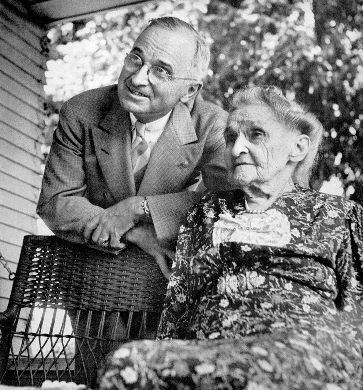 Harry S. Truman with his mother, Martha Ellen Young Truman, on the front porch of her house in Grandview, Missouri. The photograph leads the feature story,