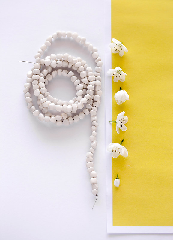 White beads and spring flowers