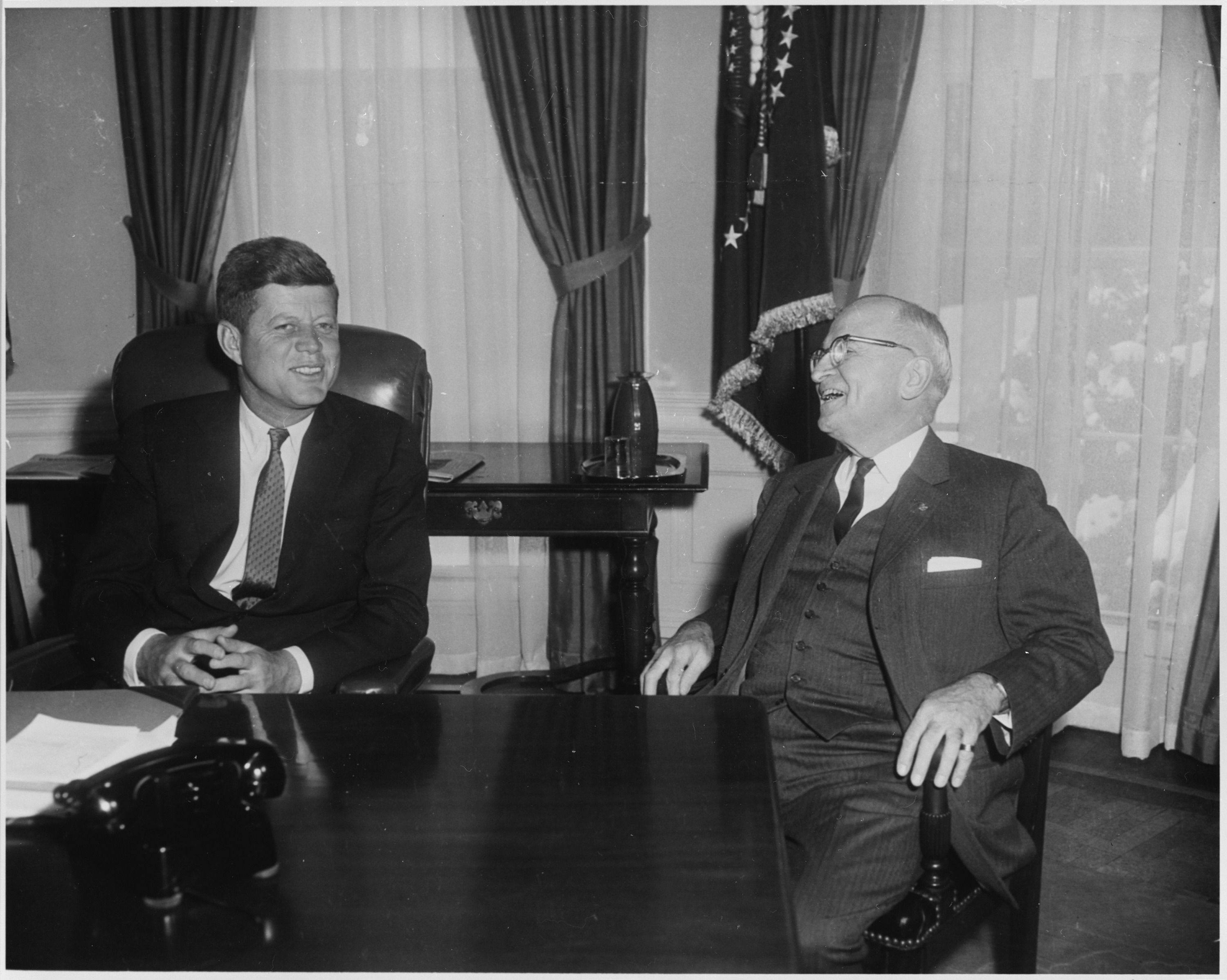 John F. Kennedy and Harry Truman in the Oval Office on January 20, 1962. Photo from the holdings of the National Archives and Records Administration. Office of Presidential Libraries. Harry S. Truman Library. (04/01/1985 - ), cataloged under the National Archives Identifier (NAID) 200435.