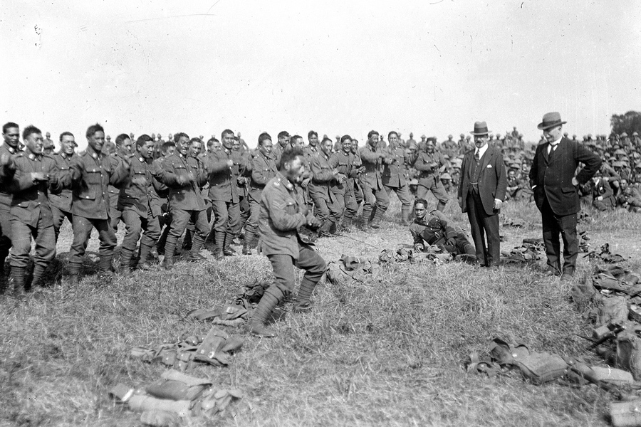Members of New Zealand's Maori Pioneer Battalion perform a haka for New Zealand's Prime Minister William Massey and Deputy Prime Minister Sir Joseph Ward in Bois-de Warnimont, France, during World War I, on June 30, 1918.