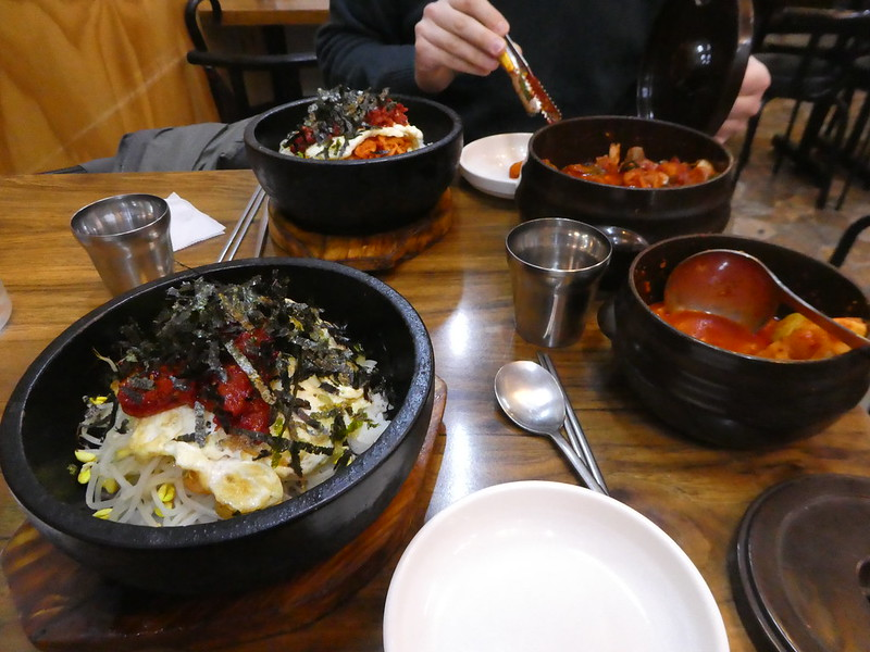 Bibimbap served with kimchi side dishes, Seoul