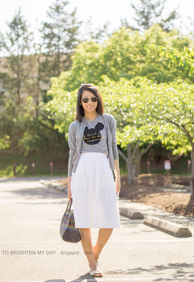 gray cardigan, gray graphic tee, white midi skirt, gray tote, white flats with embellishments