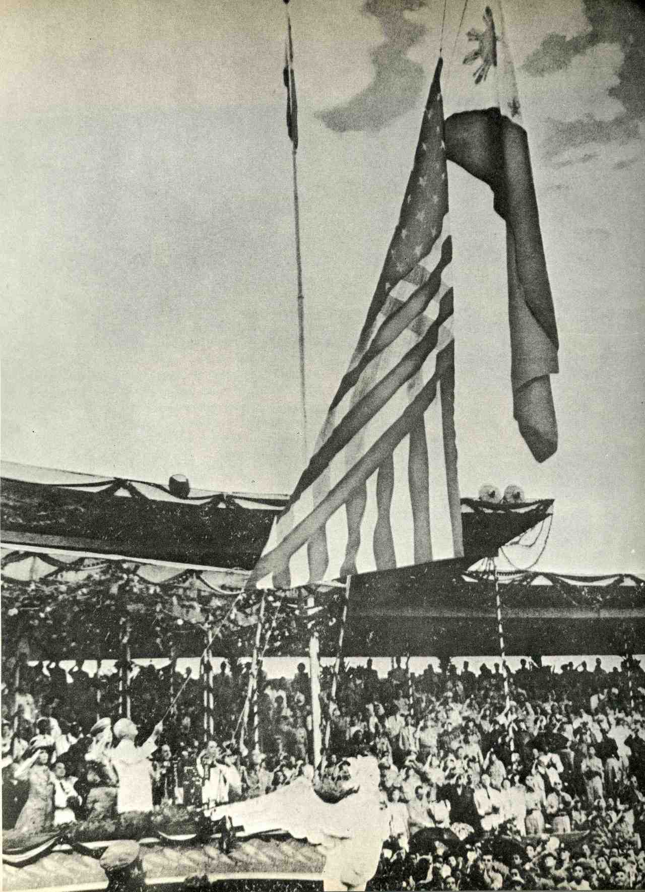 The Flag of the United States of America is lowered while the Flag of the Philippines is raised during the Independence Day ceremonies on July 4, 1946