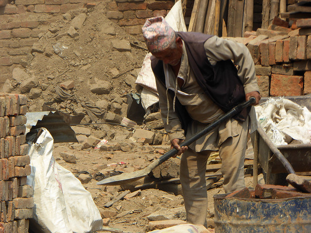 Old nepalese man beginning  clearing rubble cause by the 2015 Nepalese  Earthquake