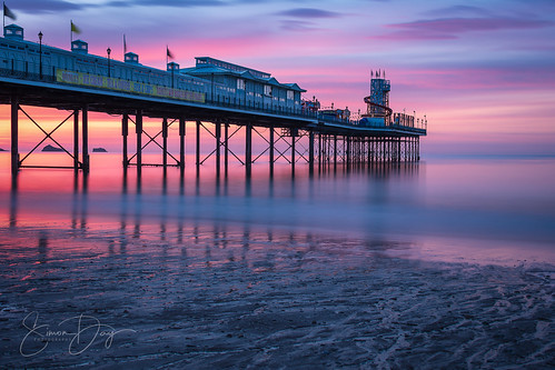 paignton pier paigntonpier devon torbay sea waves reflection reflections sunrise dawn clouds redsky sky beach water