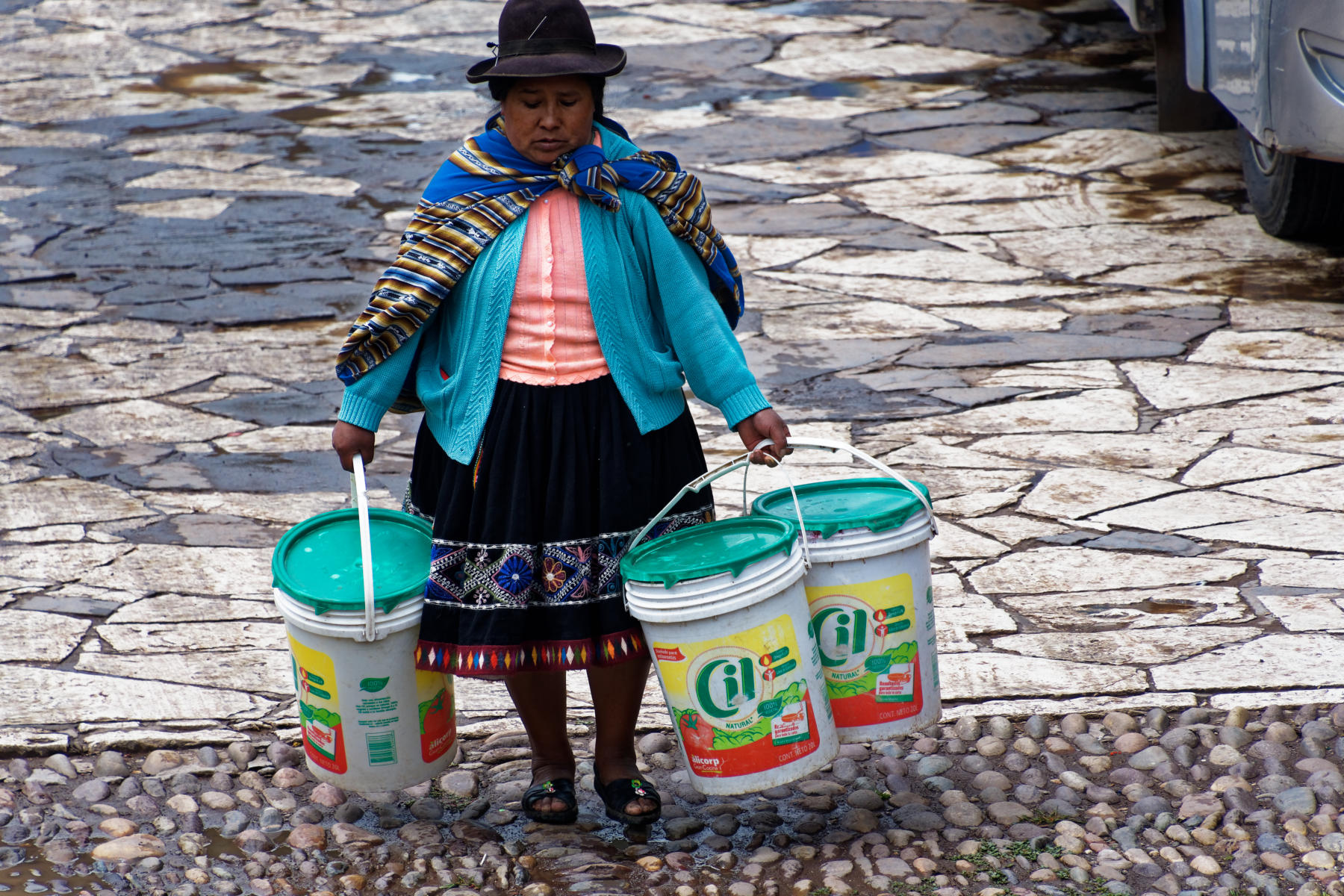 Pisac - lady carrying milk to market