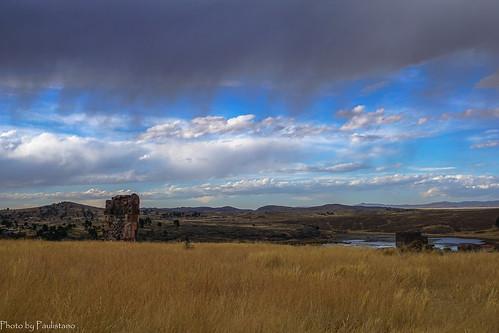 travel peru andes altiplano sky sillustani lake landscape grass