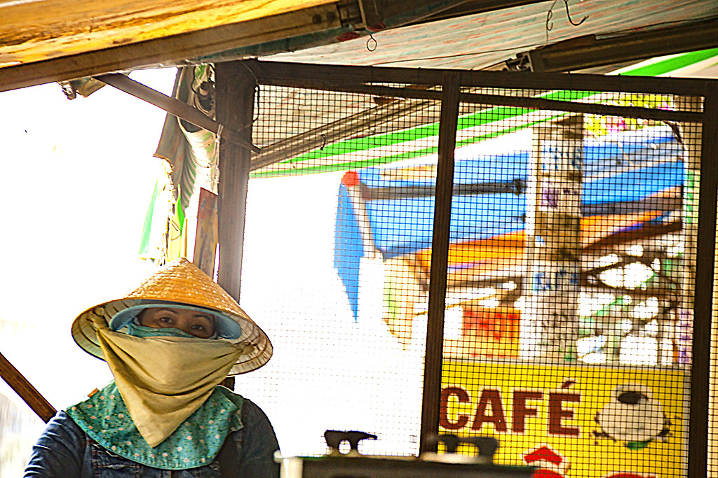 Woman showing only her eyes--Saigon