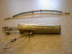 glasses(0.0), wire(0.0), jewellery(0.0), bangle(0.0), bracelet(0.0), brass(1.0),