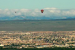 paragliding(0.0), sea(0.0), aircraft(1.0), parachute(1.0), hot air balloon(1.0), vehicle(1.0), air sports(1.0), hill(1.0), extreme sport(1.0), hot air ballooning(1.0), aerial photography(1.0), flight(1.0),