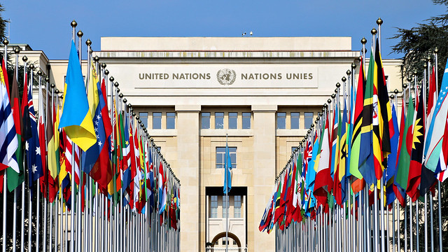 United Nations building in Geneva behind member states' flags