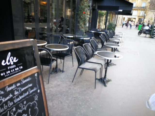 Paris caf chairs facing the street