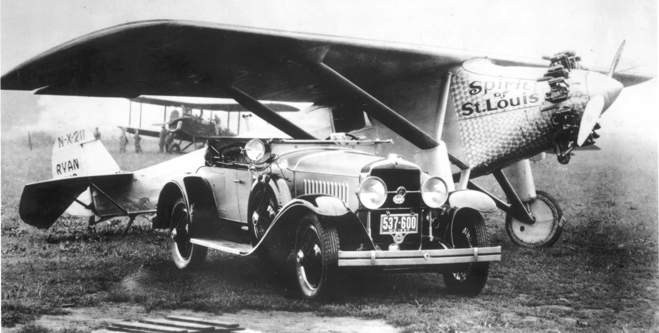 The Spirit of St. Louis and a 1927 LaSalle roadster in which the manager of Lambert Field picked up Lindbergh upon his arrival in St. Louis on August 15, 1927.