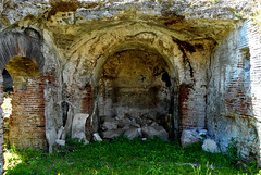"""Room ending in an apse (2nd century AD), perhaps """"sacellum"""" (=chapel) for gladiator divinities or emperor worship - Amphitheater of Pozzuoli / Naples"""