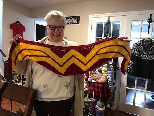 Melanie with the Wonder Woman Wrap she knit her granddaughter!