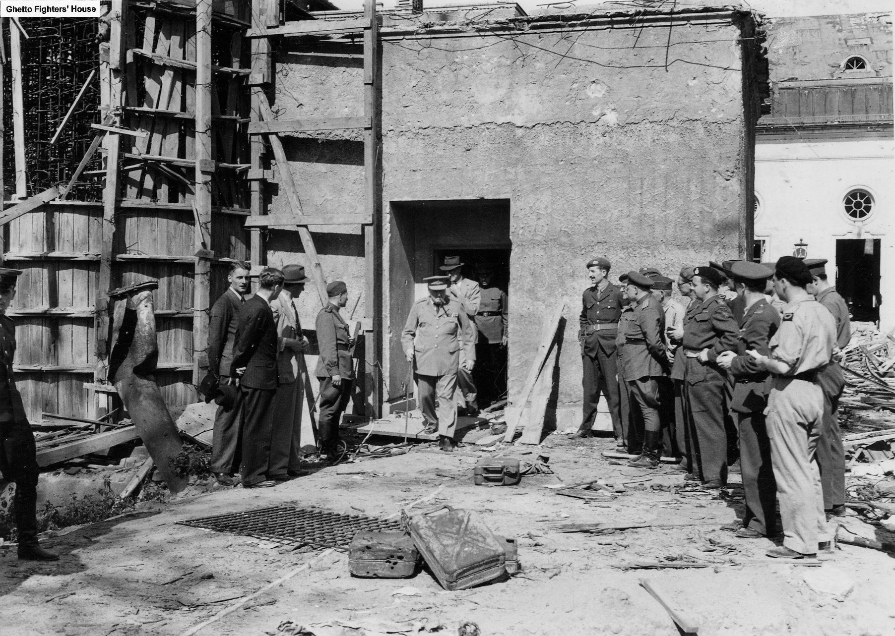 Winston Churchill exits the Führerbunker during a visit in July 1945.