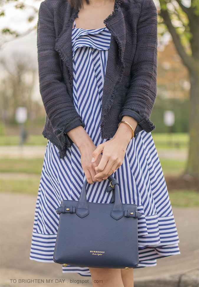 navy tweed draped jacket, striped ruffle midi dress, blue tote, rose gold jewelry