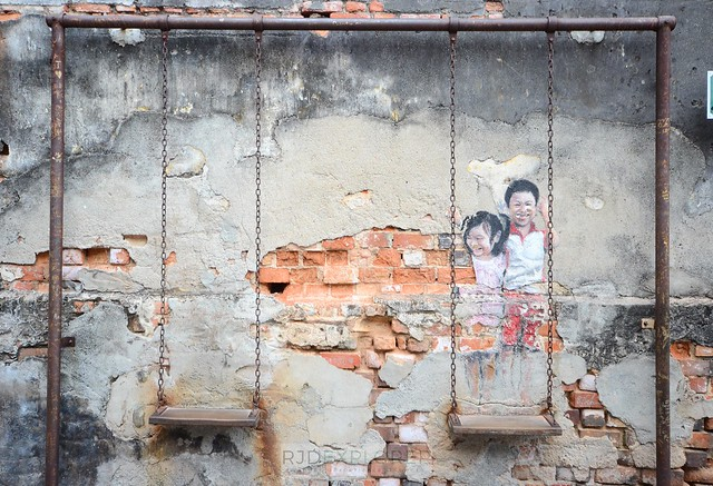penang island itinerary travel guide penang art kids on a swing