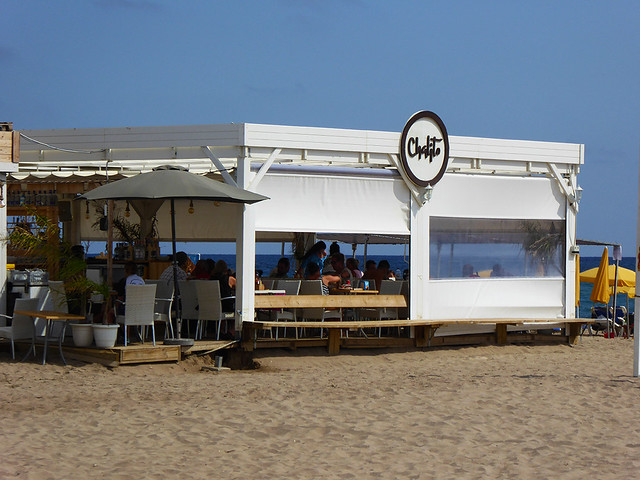 Scattered along the length of many popular coastal beaches in Spain are open sided bars and cafes that serve the thousands of beachgoers.