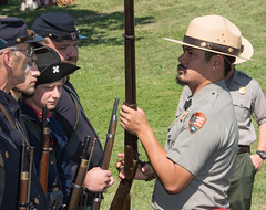 National Park Service Ranger Performs a Safety Check on a Reenactor's Rifle