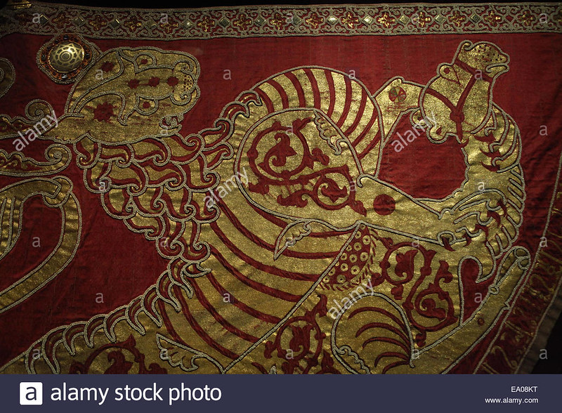 a-tiger-hunts-a-camel-detail-of-the-coronation-mantle-1133-34-palermo-EA08KT