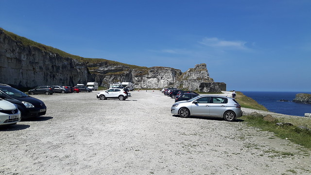 Cars parked in an old quarry along north coast of Ireland.