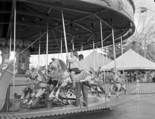 Children ride a carousel at the Brisbane Exhibition 1947