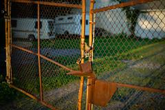 Locked gate at sunset