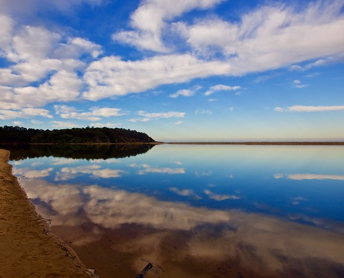 clouds reflections river lagoon mogareeka seascape tathra beach mouth bega far south coast nsw wildbeachaus