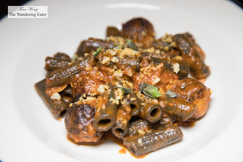 Squid ink rigatoni with tuna and prosciutto meatballs, chilies, mint and bread crumbs