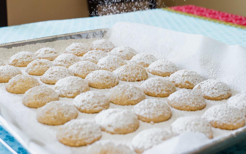 Dust Italian wedding cookies with a generous sprinkle of powdered sugar.
