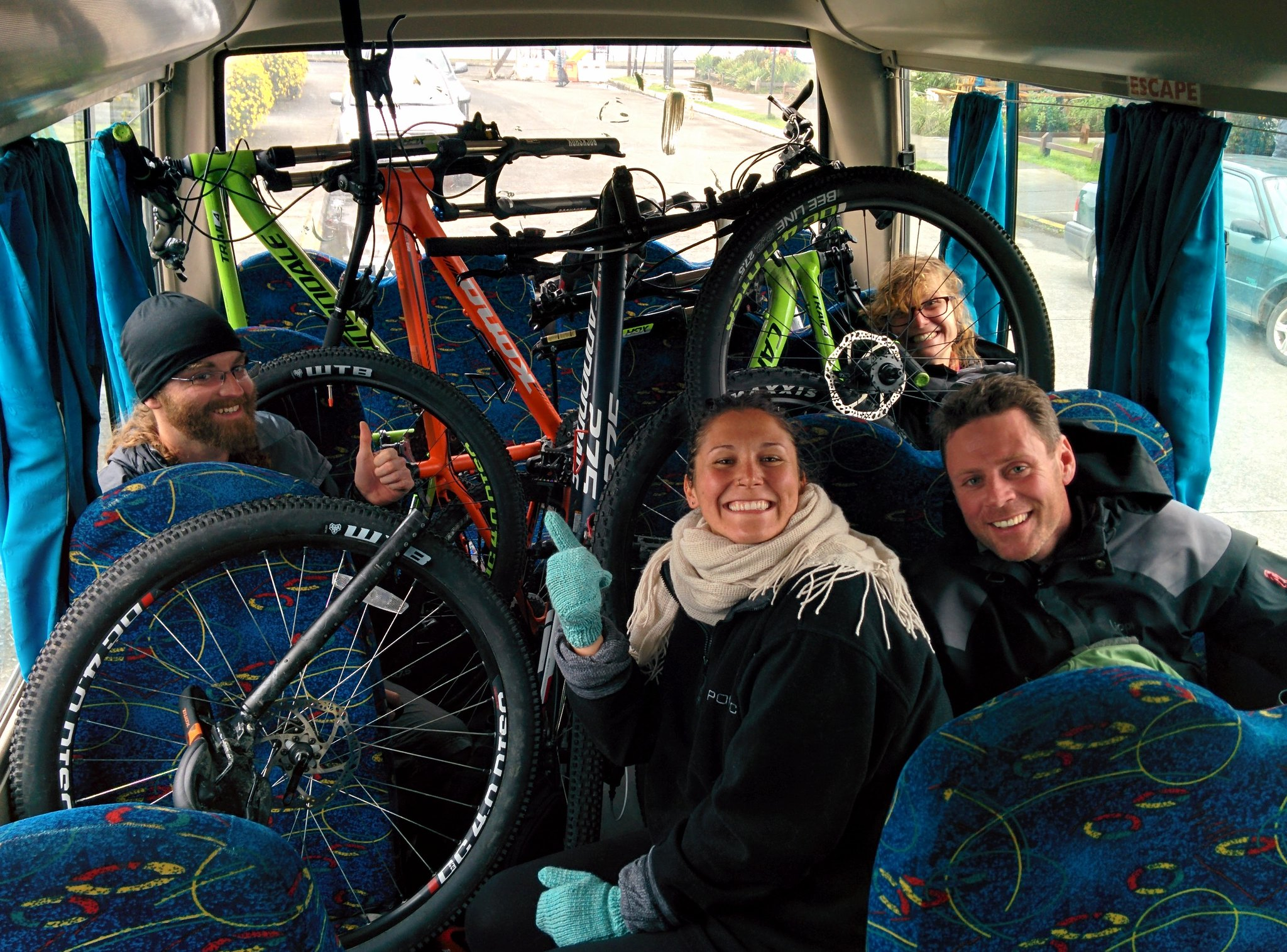 Us crammed in the back of a minibus with all our bikes